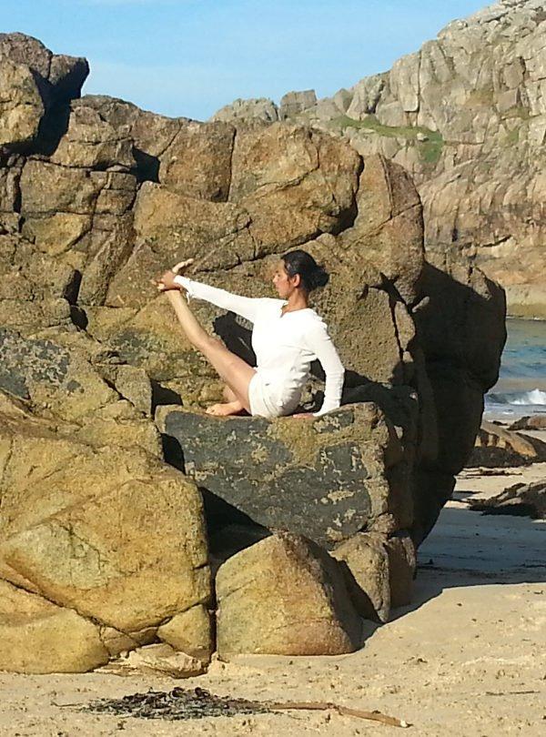 Kulbir doing yoga at the beach - parivrtta krounchasana